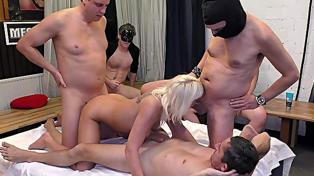 Several studs have a go with a blonde slut during rough gangbang