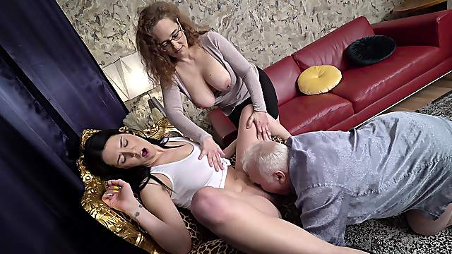 Appealing babes share senior cock in home XXX